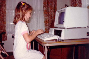 young amy at computer